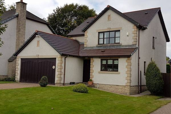 rendered two storey home with driveway
