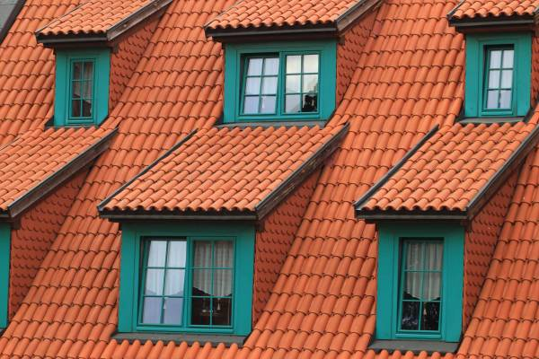 red roof with green window frames